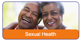Sexual Health: An African American couple standing side by side with their arms around the other's shoulders. They are smiling at the camera with their heads leaning in towards each other.